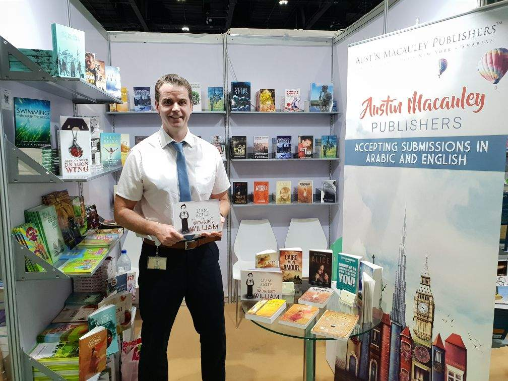 Author 'Liam Kelly' with his book 'Worried William' at Austin Macauley's stand during Abu Dhabi International Book Fair 2018.