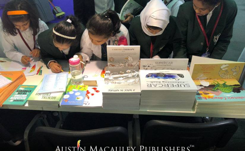Children participating in coloring activity held by Austin Macauley at SCRF18